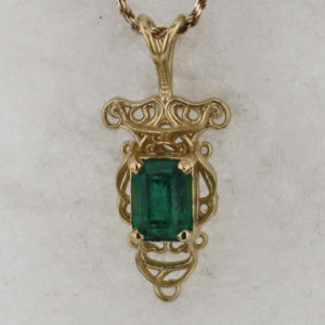 14k Yellow God and Emerald Pendant $1999