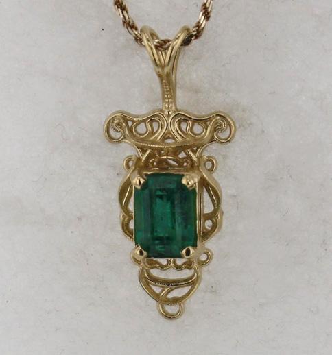 14k Yellow God and Emerald Pendant $1999