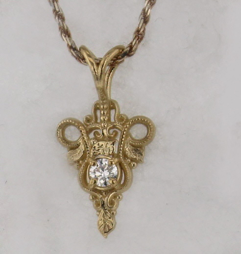 14k Yellow Gold and Diamond Pendant $759
