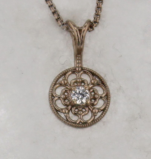 14k White Gold and Diamond Pendant $337