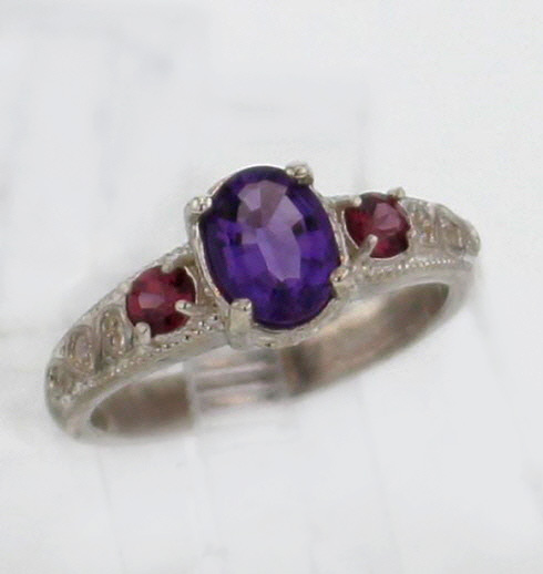 Sterling Silver and Amethyst w Garnets Ring $167