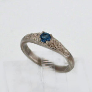 Sterling Silver and Topaz Ring $95